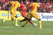 Walter Bwalya try to pass Sakala and Makodila during local derby