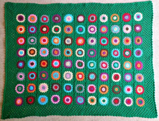finished green crochet blanket