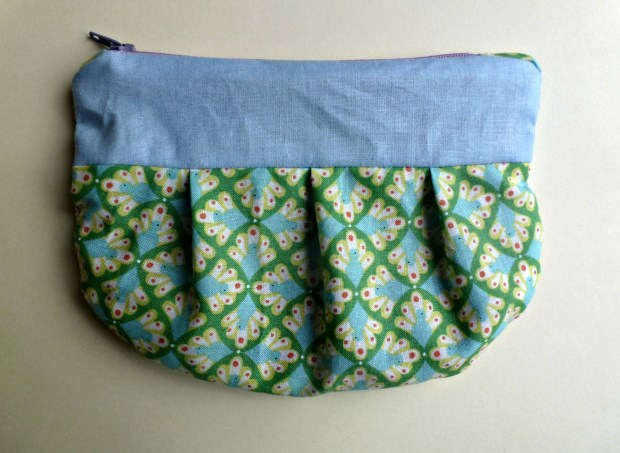 sewn purse with pleats