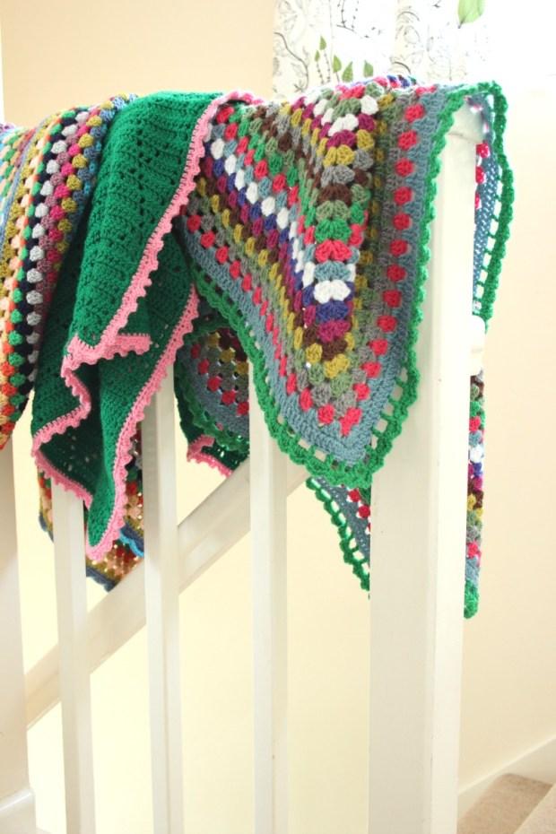 A trio of crochet blankets.