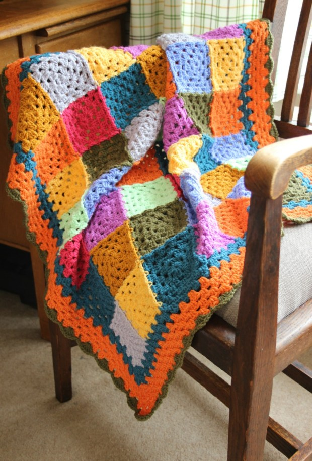 autumn-crochet-granny-square-blanket-with-orange-border