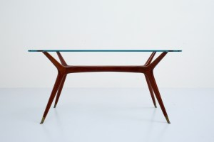Coffeetable in Mahogany and Brass and with Glass curved top, Italy, 1950's.