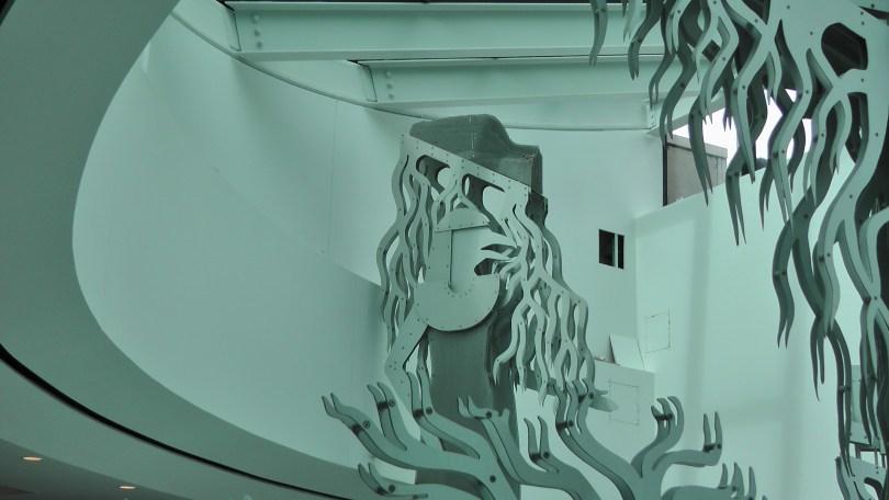 Detail of Comme si le temps... de la rue by Pierre Granche showing the mountain on Set's head.
