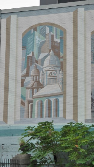 Kind of cubo-futurist painting of Montreal skyscrapers and churches.