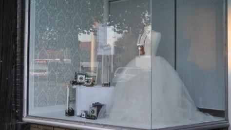 Window of a photo studio on Wellington