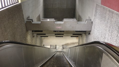 Going down the escalator inside the southern entrance to Métro Joliette.