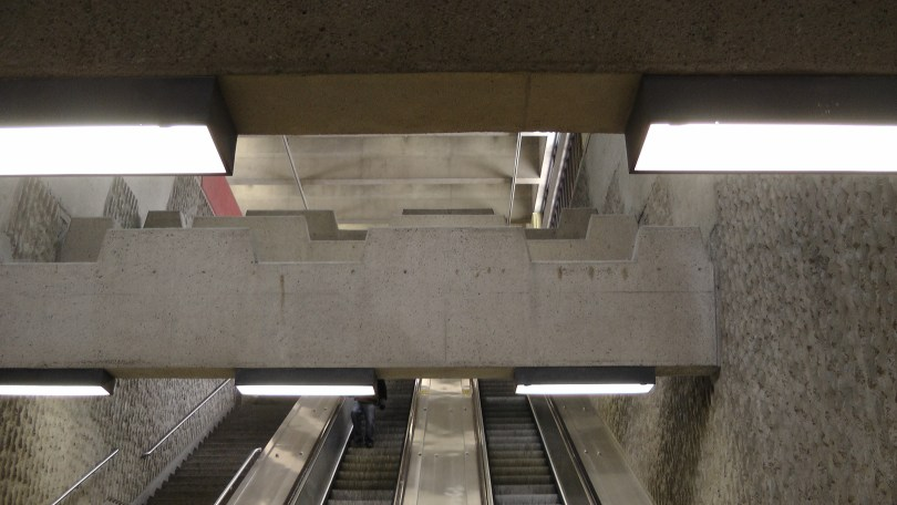 Looking up at concrete beams in the southern entrance to the Métro Joliette.