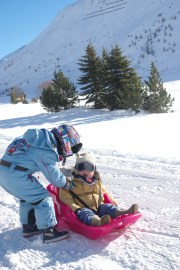 Tignes with baby and kids: sledging on the frozen lake: Esprit ski holidays