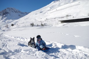 Tignes with kids horse sledges on the lake