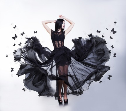 Swing. Sensual Woman in Black Fluttering Dress with Butterflies