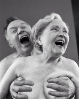 Elderly Man Holding Woman's Breasts