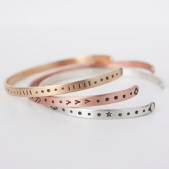 Inspirational skinny cuff set with patterns in brass, copper and sterling silver