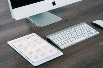"Photo of desktop Apple computer, tablet, keyboard and mouse. Caption: ""Digital organizing can bring you peace of mind"""