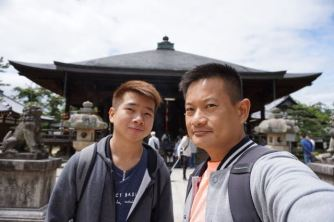 Taking a wefie in front of the main prayer hall in Chionji
