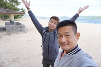 Taking a wefie on the beach facing Ine Bay