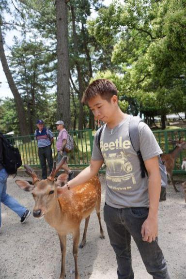 My friend patting the deer