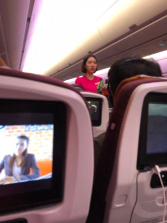 Flight Attendants on meal service