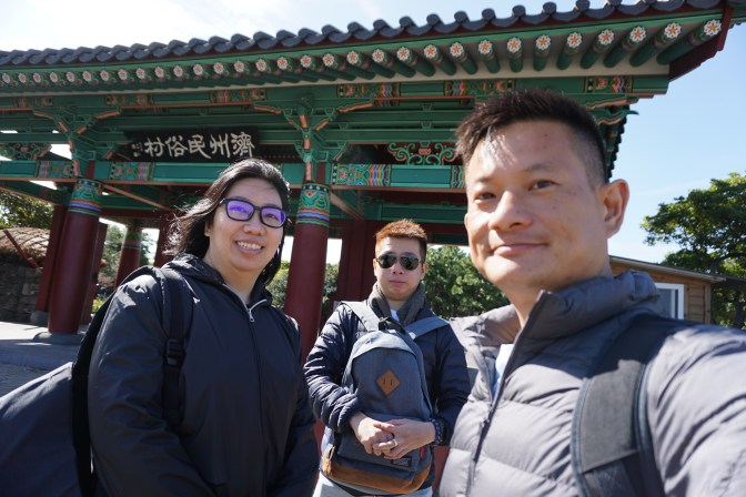 Taking a wefie at the entrance of Jeju Folk Village