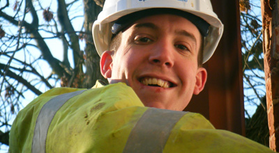 Close up of Speller Metcalfe contractor at zero carbon house Birmingham with high viz jacket and hard hat