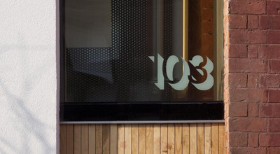 Letters 103 etched into the glass sky light above the door of zero carbon house, Birmingham