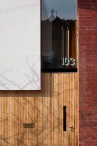 Front door of zero carbon house, Birmiingham with letter box and 103 etched into the glass skylight