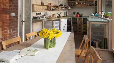 Daffodils on the table in the living room of zero carbon house Birmingham
