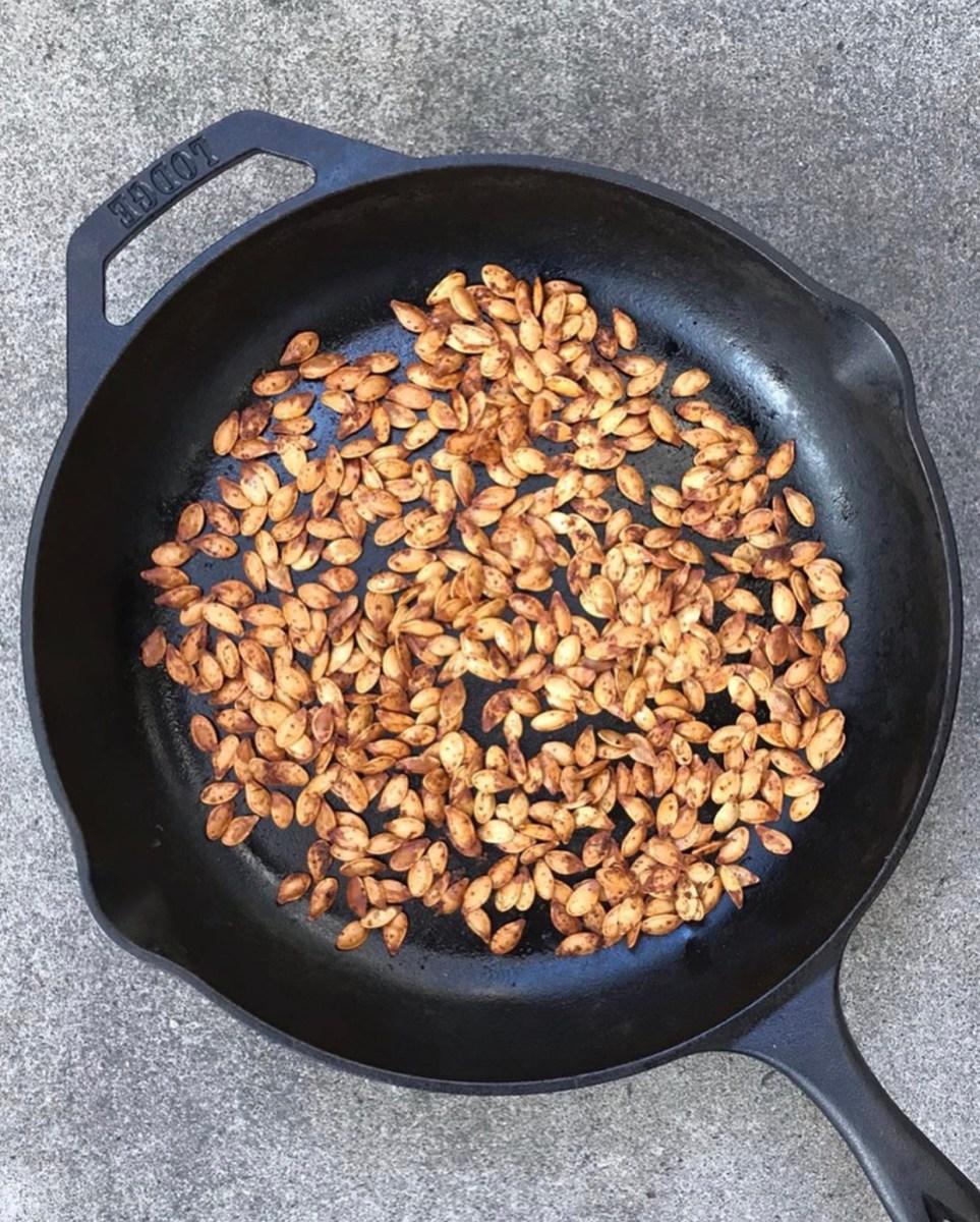 cast iron skillet used to roast pumpkin seeds