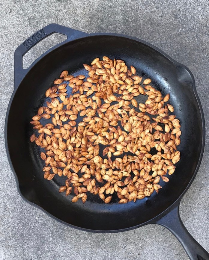 cast iron skillet used to roast pumpkin seeds
