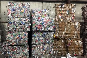 Metal and cardboard bales ready for recycling