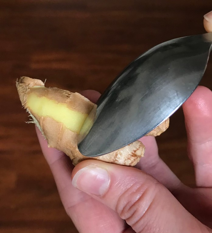 a spoon peels fresh ginger quickly and easily