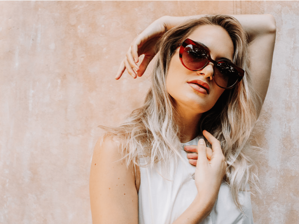 Woman wearing Truth & All sustainable sunglasses