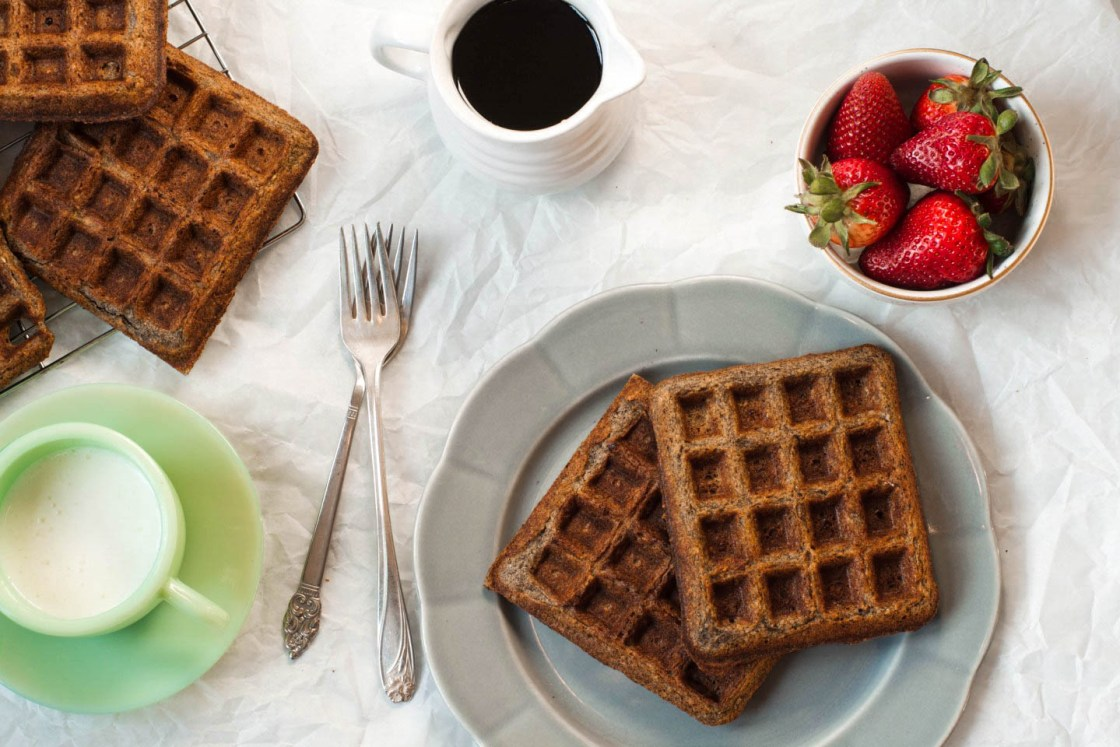 Gluten Free Buckwheat Waffles on a gray plate with milk and strawberries to the side | Zestful Kitchen