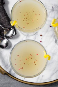 Light and refreshing, this vodka-kombucha cocktail is perfect for any occasion. Made with a pink peppercorn-cardamom syrup and lemon-ginger kombucha, this drink has incredible depth of flavor and festive flare. | Zestful Kitchen