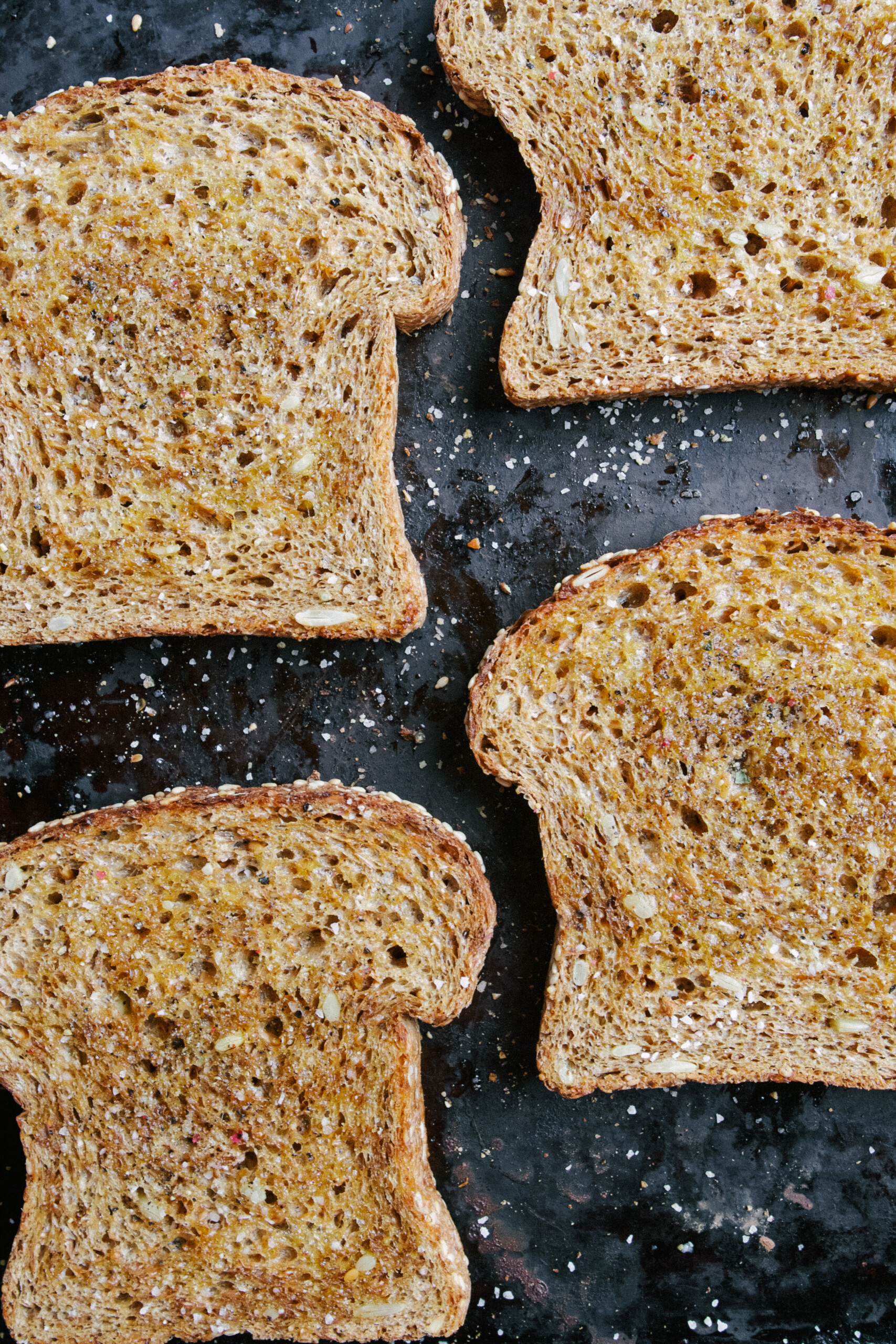 Toasted whole grain bread gets topped with creamy smoked gruyere, salty ham, and slices of honeycrisp apple. It gets broiled to melty perfection then drizzled with honey and earthy thyme, these toasts are perfect for breakfast, lunch, or dinner. | Zestful Kitchen