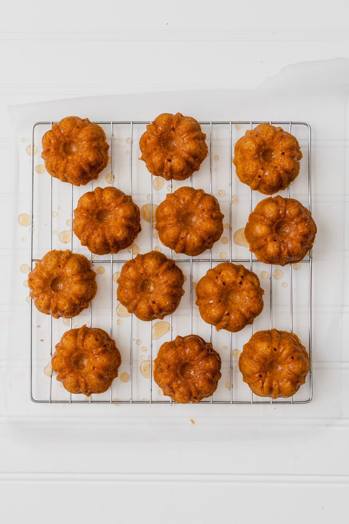 Tender tea cakes flavored with fresh grapefruit and Campari. These mini cakes are naturally sweetened with honey, easy to whip, and elegant enough for a fancy party. | from Lauren Grant of Zestful Kitchen