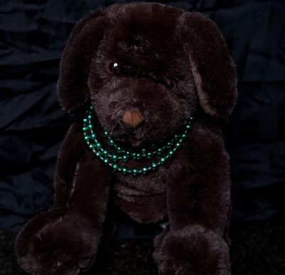 Brookstone n. a. p. Brown Dog Sitting Stuffed Animal  With Green Necklace NWOT