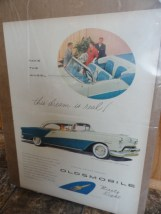 Vintage Oldsmobile Ninety Eight Deluxe Holiday Coupe Advertisement