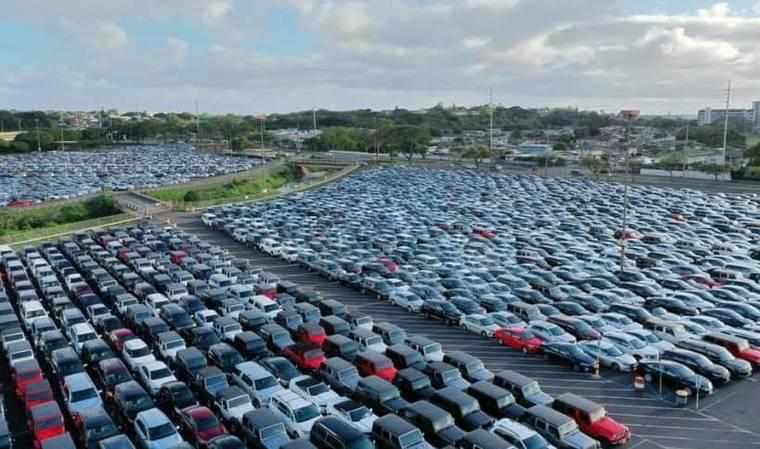 Aloha Stadium's parking lot has become the temporary home to 1,000 to 1,500 rental vehicles on Oahu that have become idle because of the novel coronavirus pandemic.