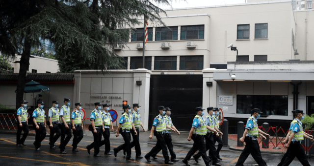 Massive Chinese security presence outside of the US consular building in Chengdu on Saturday, via Reuters.