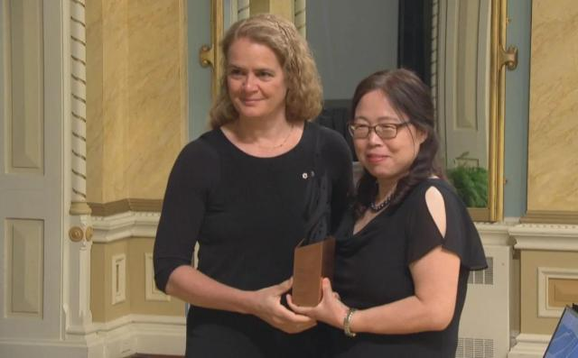 Dr. Xiangguo Qiu accepting an award at the Governor General's Innovation Awards at a ceremony at Rideau Hall in 2018. Qiu is a prominent virologist who helped develop ZMapp, a treatment for the deadly Ebola virus which killed more than 11,000 people in West Africa between 2014-2016. (CBC)