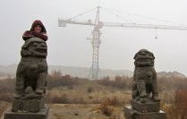 If I could summarize China in a picture, this one is pretty close to perfect. Ancient statues, construction, and fog. It needs a little more color, I suppose.