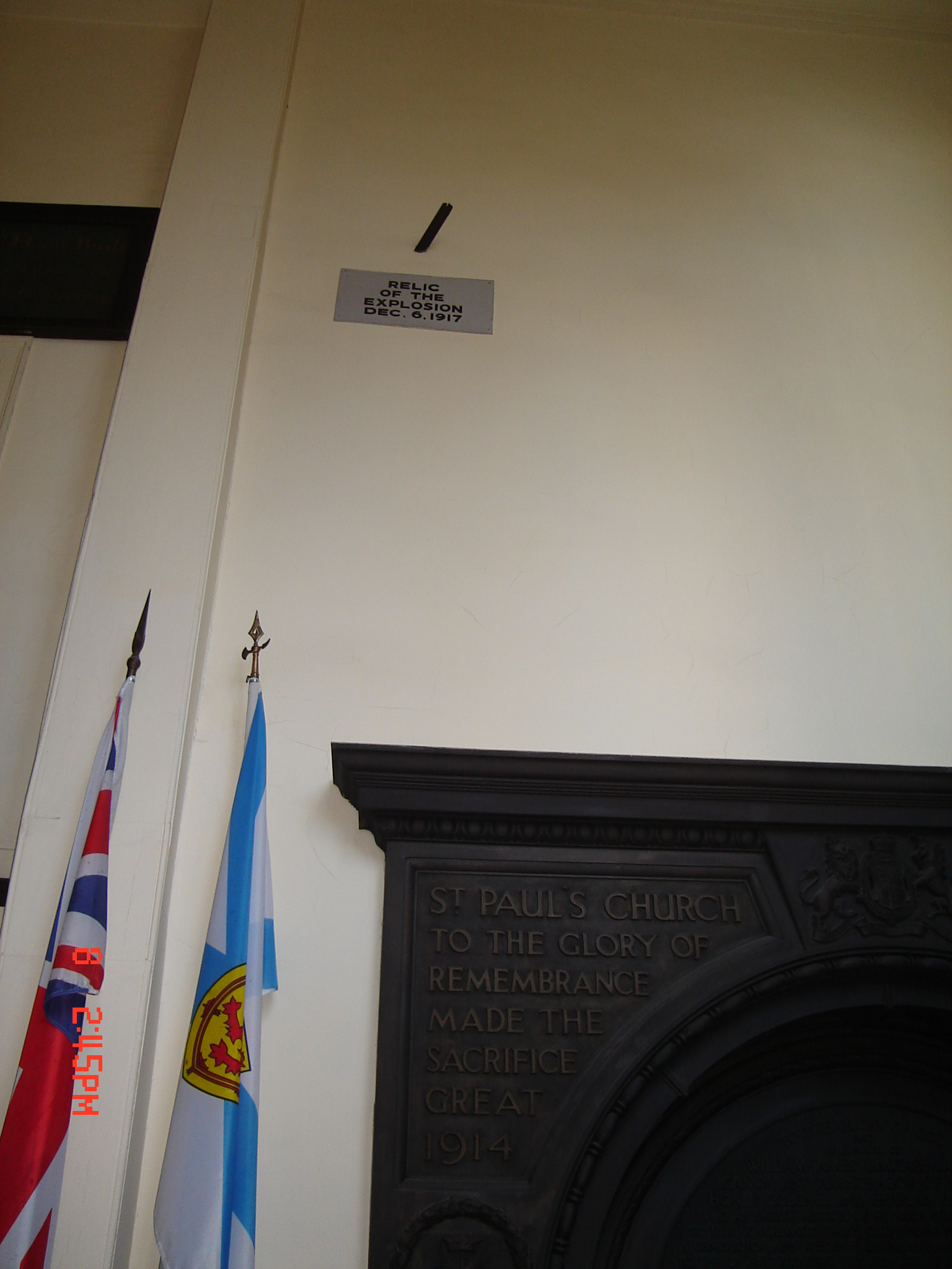 the-piece-of-metal-from-mont-blanc-remains-flown-through-the-glass-window-and-then-embedded-above-the-door-in-the-inside-wall-of-the-porch-of-st-paul_s-anglican-church