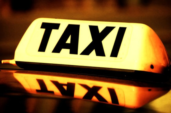 close up on a yellow taxi cab sign