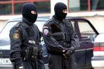 Armă deținută fără drept găsită la percheziție