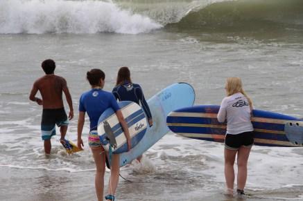 Surf lesson entering the ocean