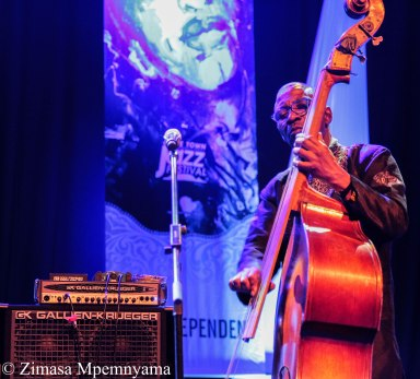 Bassist Herbie Tsoaeli accompanying Thandiswa Mazwai at the Rosies stage of the 18th Cape Town International Jazz Festival