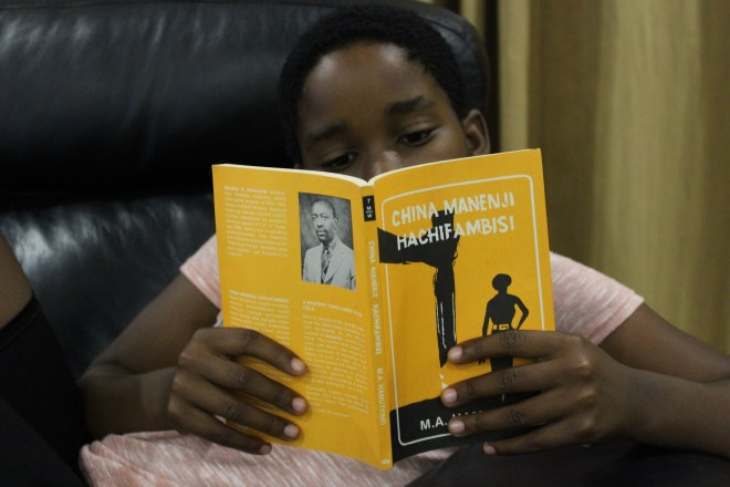 young girl reading a Shona novel