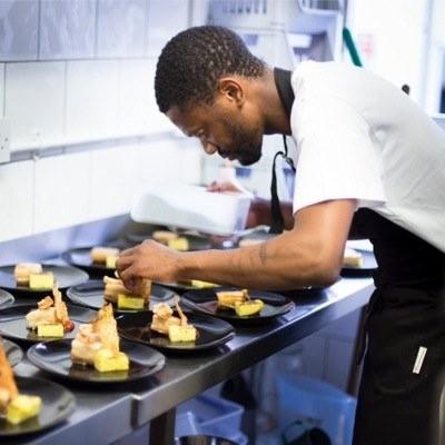 Chef Sheu Mhaka plating up