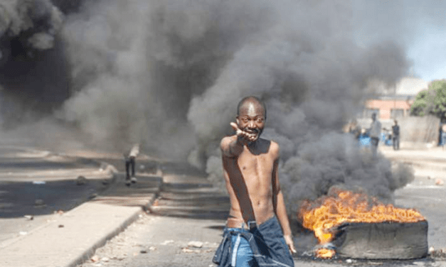 Politician, DJ arrested for burning cars, stoning clinic