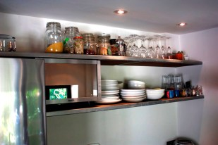 Bespoke open kitchen shelving in lacquered steel